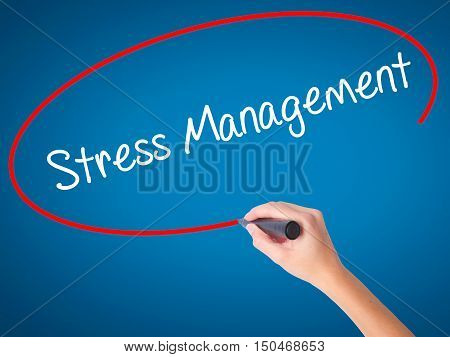 Women Hand Writing Stress Management With Black Marker On Visual Screen