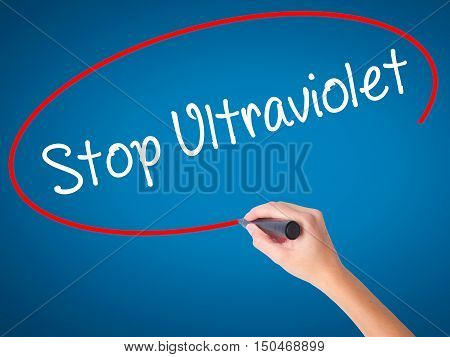 Women Hand Writing Stop Ultraviolet With Black Marker On Visual Screen