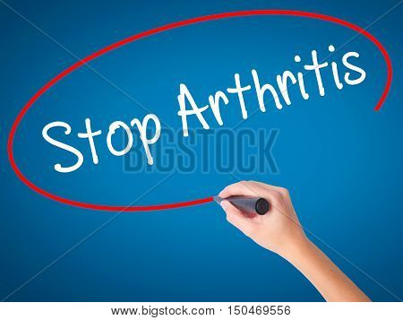 Women Hand Writing Stop Arthritis With Black Marker On Visual Screen