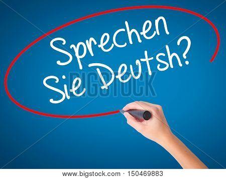 Women Hand Writing Do You Speak German? (in German) With Black Marker On Visual Screen