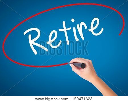 Women Hand Writing Retire With Black Marker On Visual Screen
