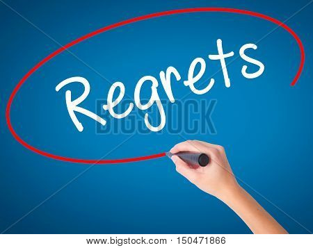 Women Hand Writing  Regrets With Black Marker On Visual Screen