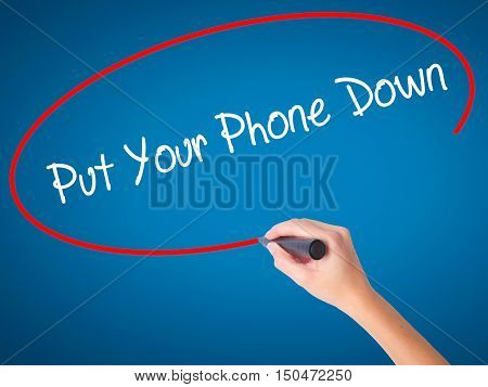 Women Hand Writing Put Your Phone Down With Black Marker On Visual Screen