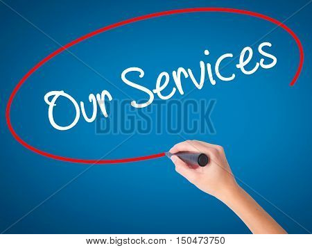 Women Hand Writing Our Services With Black Marker On Visual Screen