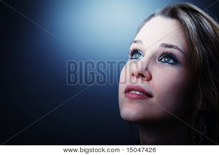 Hopeful Young Woman Glancing Into Her Future