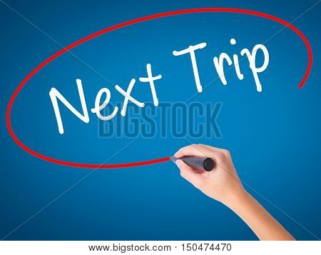 Women Hand Writing Next Trip With Black Marker On Visual Screen