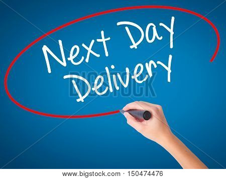 Women Hand Writing Next Day Delivery With Black Marker On Visual Screen.