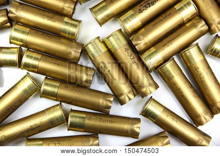 A pile of shotgun cartridges on a white background