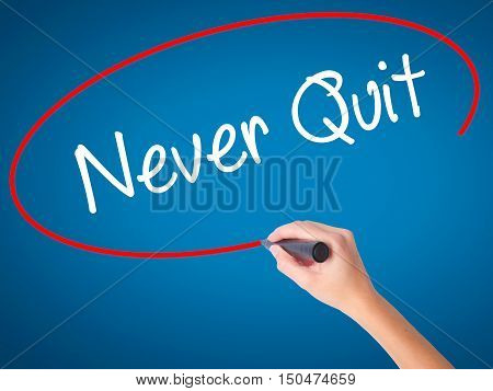 Women Hand Writing Never Quit With Black Marker On Visual Screen.