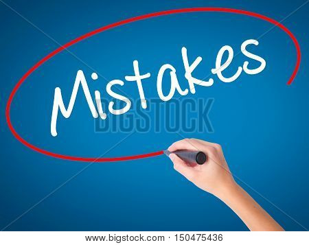 Women Hand Writing  Mistakes With Black Marker On Visual Screen