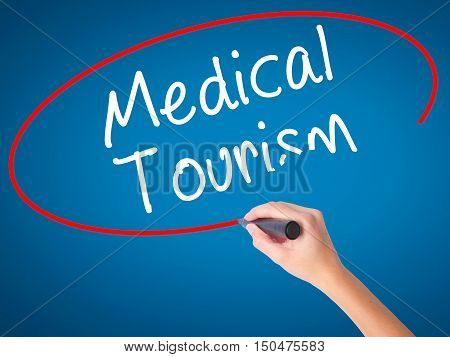 Women Hand Writing Medical Tourism With Black Marker On Visual Screen
