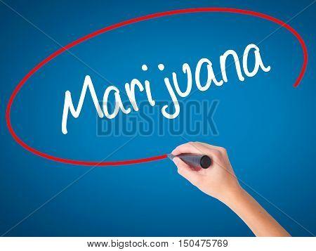 Women Hand Writing Marijuana With Black Marker On Visual Screen