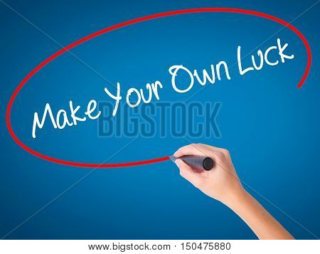 Women Hand Writing Make Your Own Luck With Black Marker On Visual Screen