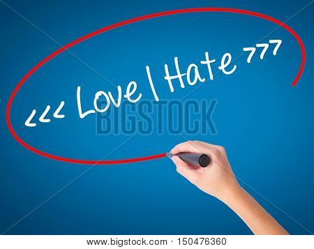 Women Hand Writing Love - Hate  With Black Marker On Visual Screen