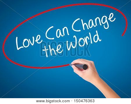Women Hand Writing Love Can Change The World With Black Marker On Visual Screen