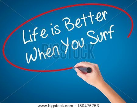 Women Hand Writing Life Is Better When You Surf With Black Marker On Visual Screen.