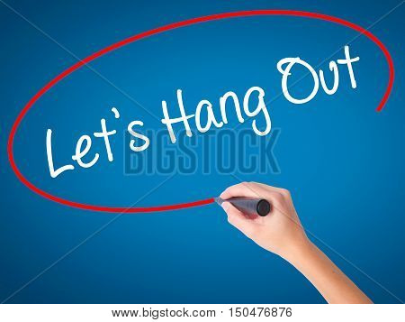 Women Hand Writing Let's Hang Out With Black Marker On Visual Screen