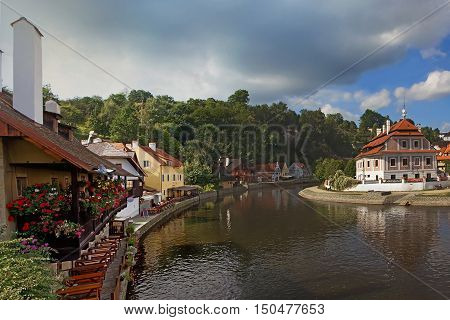 Landscape with Vltava River homes and trees in city Cesky Krumlov Czech Republic