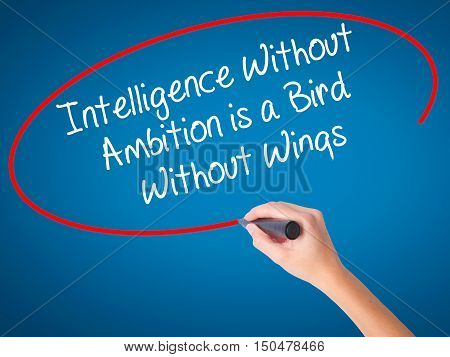 Women Hand Writing Intelligence Without  Ambition Is A Bird  Without Wings With Black Marker On Visu