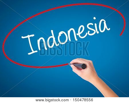 Women Hand Writing Indonesia  With Black Marker On Visual Screen