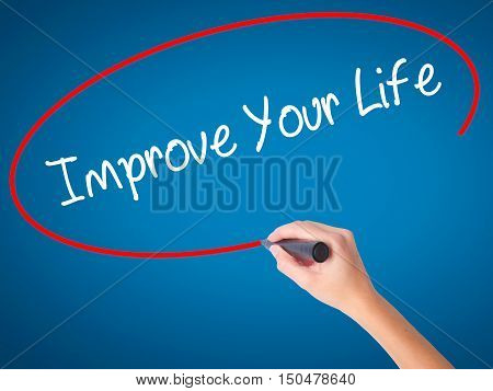 Women Hand Writing Improve Your Life With Black Marker On Visual Screen.
