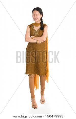 Portrait of young mixed race Indian Chinese girl in traditional punjabi dress smiling and looking at camera, full length standing isolated on white background.