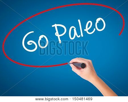Women Hand Writing Go Paleo With Black Marker On Visual Screen
