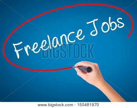 Women Hand Writing Freelance Jobs With Black Marker On Visual Screen