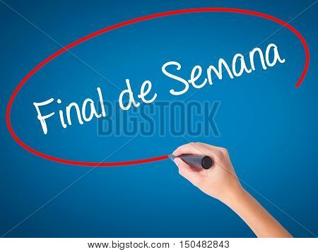 """Women Hand Writing """"final De Semana"""" (in Portuguese - Weekend) With Black Marker On Visual"""