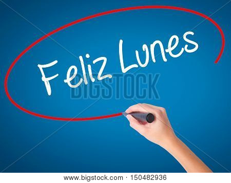 Women Hand Writing Feliz Lunes (happy Monday In Spanish) With Black Marker On Visual Screen
