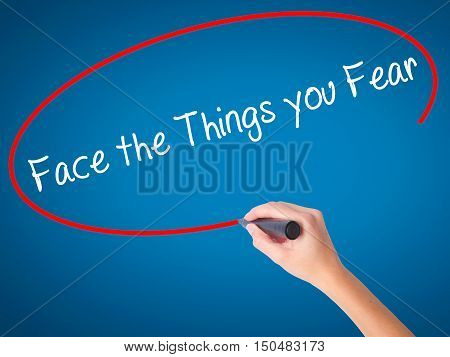 Women Hand Writing Face The Things You Fear With Black Marker On Visual Screen