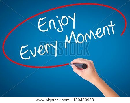 Women Hand Writing Enjoy Every Moment With Black Marker On Visual Screen.