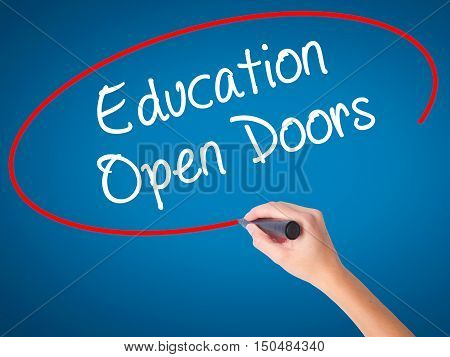 Women Hand Writing Education Open Doors With Black Marker On Visual Screen