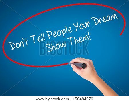 Women Hand Writing Don't Tell People Your Dream