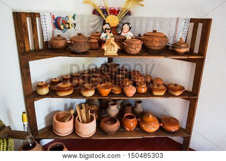 Shelves With Standing On Their Utensils Of Porcelain And Earthenware