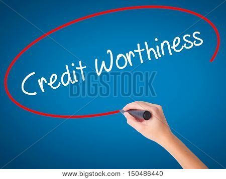 Women Hand Writing Credit Worthiness With Black Marker On Visual Screen
