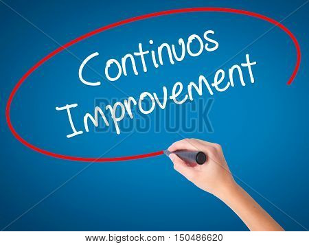 Women Hand Writing Continuos Improvement With Black Marker On Visual Screen
