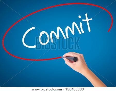 Women Hand Writing Commit With Black Marker On Visual Screen