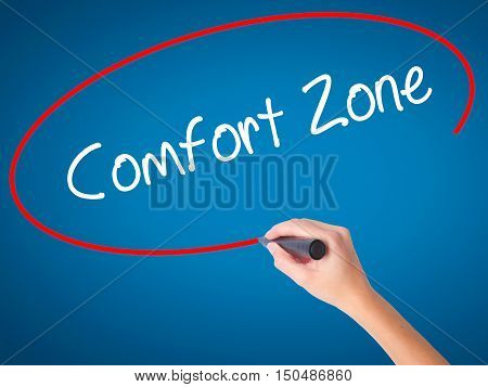 Women Hand Writing Comfort Zone With Black Marker On Visual Screen