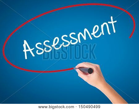 Women Hand Writing Assessment With Black Marker On Visual Screen