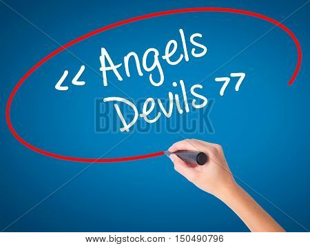 Women Hand Writing Angels - Devils With Black Marker On Visual Screen.