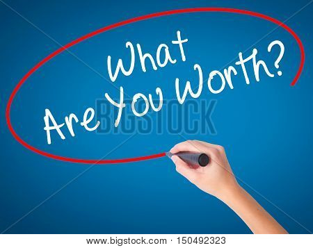 Women Hand Writing What Are You Worth? With Black Marker On Visual Screen