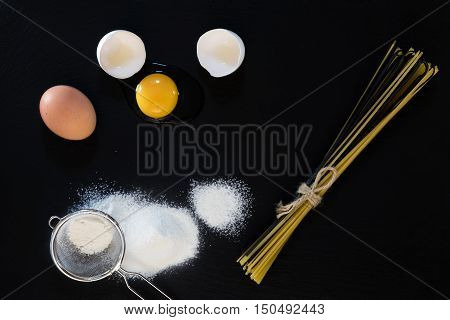Traditional And Black Uncooked Italian Pasta Linguine With White And Brown Chicken Eggs