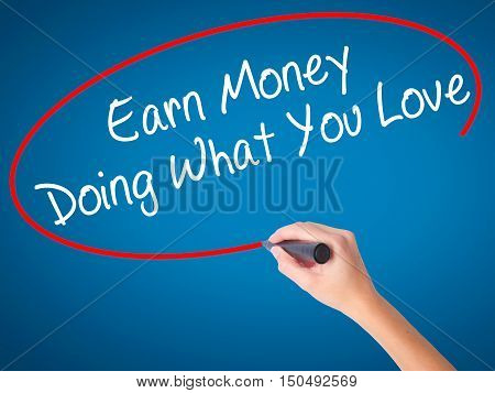 Women Hand Writing Earn Money Doing What You Love With Black Marker On Visual Screen