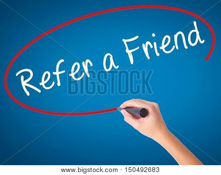 Women Hand Writing Refer A Friend  With Black Marker On Visual Screen