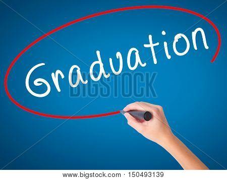 Women Hand Writing Graduation With Black Marker On Visual Screen