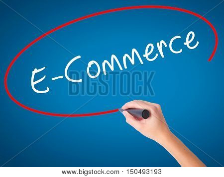 Women Hand Writing E-commerce With Black Marker On Visual Screen