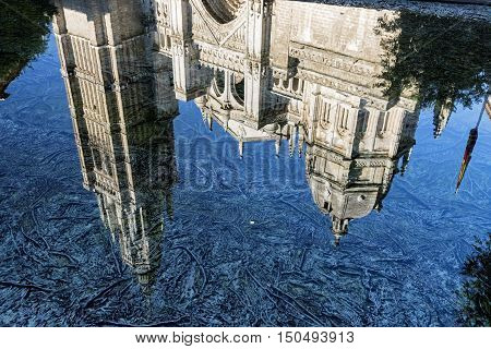 Toledo (Castilla-La Mancha Spain): facade of the medieval cathedral in gothic style reflected in a fountain