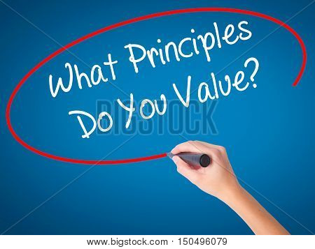 Man Hand Writing What Principles Do You Value? With Black Marker On Visual Screen