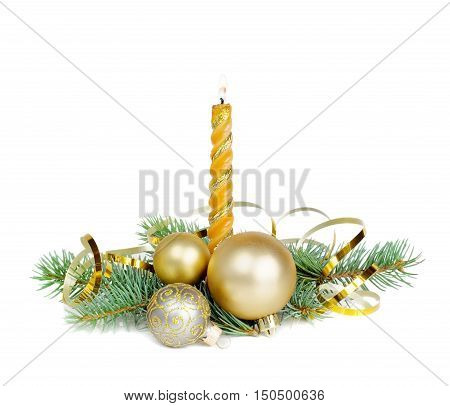 Christmas composition with a burning candle fir branches Christmas balls and golden serpentine isolated on a white background
